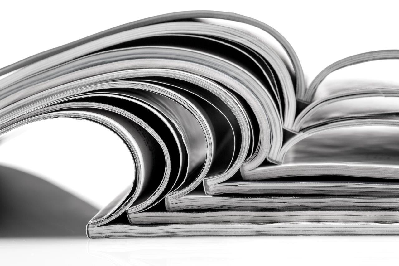bigstock Stack Of Magazines On White Ba 75638749